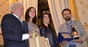 Io e Luca, socio fondatore Forno Zogno, che riceviamo il premio dalle mani del presidente dell'associazione Antichi Mestieri e dal vice sindaco Eleonora Mosco